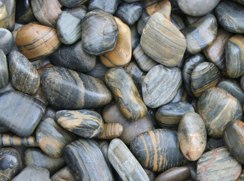 Kashmiri Polished Tiger Stripe Decorative Pebbles available from The Yard Landscape Centre in Doonan